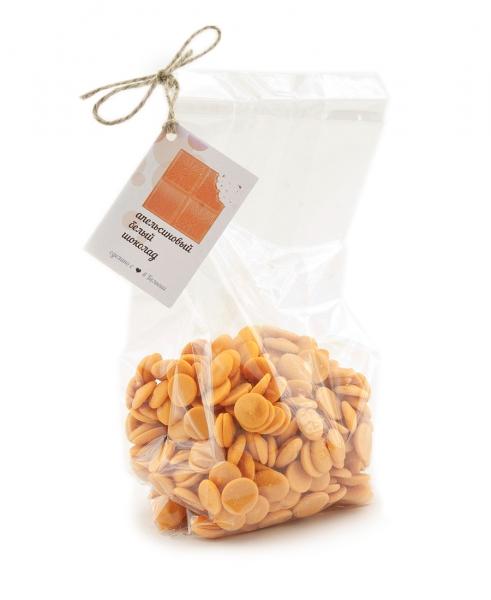 Фото 1. Белый шоколад со вкусом апельсина Callebaut в форме дисков.
